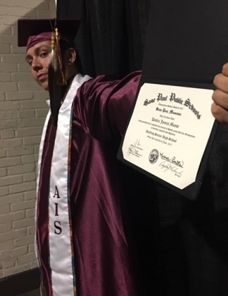 V - American Indian graduate with diploma