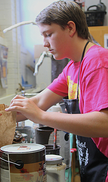 V - CTE Student  working on project