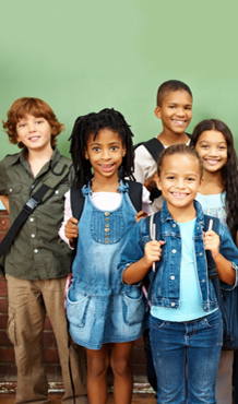 V - Smiling Group of Elementary Students with Backpacks