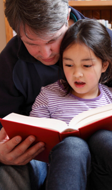 Dad Helping Daughter with Reading