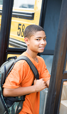 Student Getting on School Bus