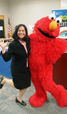 Commissioner Cassellius with Elmo Help Raise Awareness and Support Families Affected by Incarceration