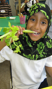 Young Girl Snacking on Fresh Celery