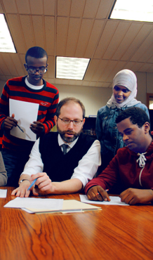 V - Male Teacher Reviews Papers with Somali High School Students