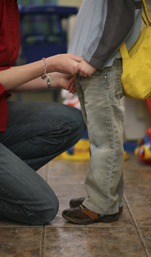 V - Adult Female Holds Hands While Talking to Young Boy, No Faces