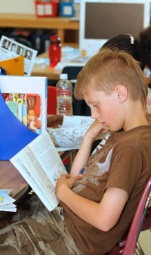 V- Gr 4 boy engaged in book